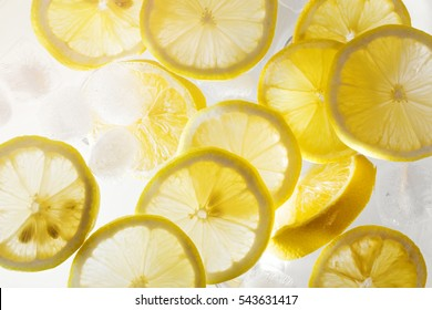 refreshing water with lemon slices and ice cubes