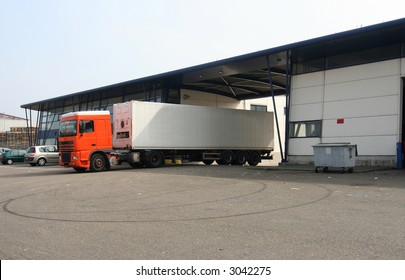 Refrigerated truck leaving the loading dock