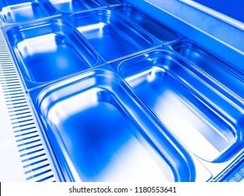 Refrigeration chamber for food storage. Refrigeration chamber with pallets. Industrial cold store for food storage. Metal pallets for the refrigerating chamber.