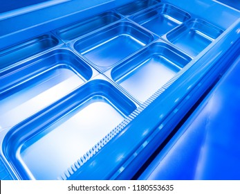 Refrigeration plant for food. Storage of food in the refrigerator. Metal pallets for the refrigerating chamber. Industrial refrigerator. Commercial equipment with a refrigerating chamber.