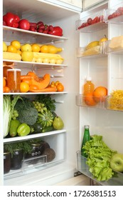Refrigerator, content. Color diet. Organic food, fruits, vegetables. Rainbow food in fridge, refrigerator. Healthy, dietary nutrition. Multicolored nutrition for vegetarians, vegans. Products for diet