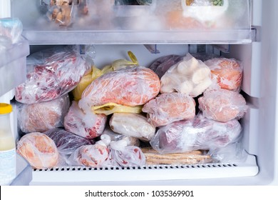 Refrigerator with frozen food (meat, milk, vegetables). Ready meal
