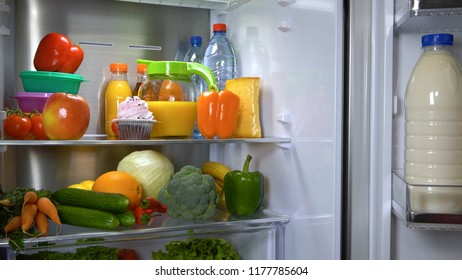Refrigerator full of fruits and vegetables. Fridge icebox with wholesome food.