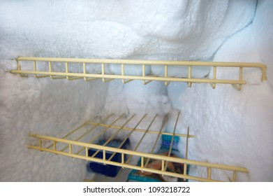 Refrigerator with ice frozen in fridge with food need to be defrost.