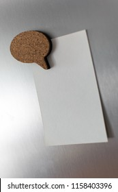 Refrigerator magnets in shape of text clouds.