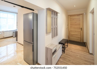 Refrigerator, metallic color, stainless steel in the kitchen.