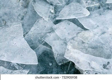 Refrozen ice fragments in top view - landscape format; Ice surface for background; Frozen water surface; Danger on thin ice