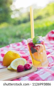 Refrshing lemonade served with fruit on a summer picnic