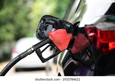 Refueling Car fill with petrol gasoline at  gas station and Petrol pump filling fuel nozzle in fuel tank of car