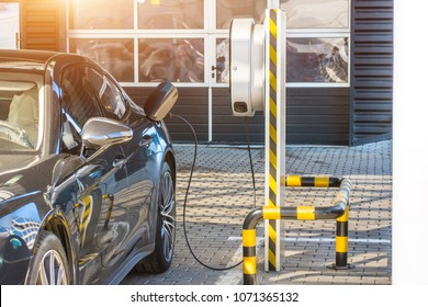 Refueling for electric cars e-mobility. Charging the machine, compartment door is open, the electric plug under voltage restores the battery charge