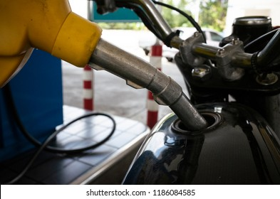 refueling motorbike at gas staion