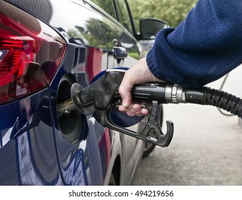 Refuelling car/automobile; filling petrol or gas tank at filling station