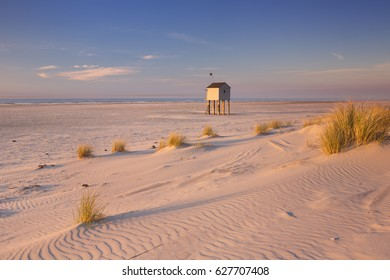Refuge hut on the beach of the island of Terschelling in The Netherlands. Photographed at sunset.