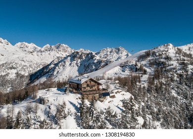 Refuge in mountain, winter landscape.