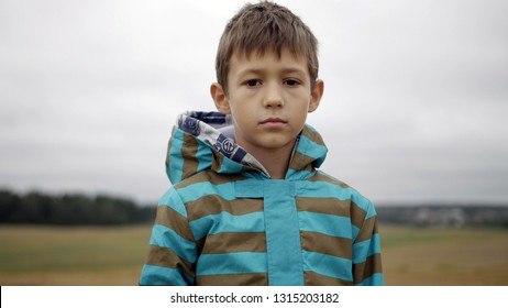 Refugee Boy Looks Compassionately At The Camera, Homeless Boy, Pain On Face