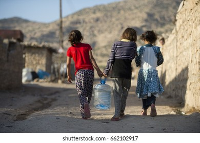 REFUGEE CAMP, DOHUK, KURDISTAN, IRAQ - 2014 AGUST 13 - A Yazidi people who escaped abuse from ISIS outside her tent in Kanke refugee camp