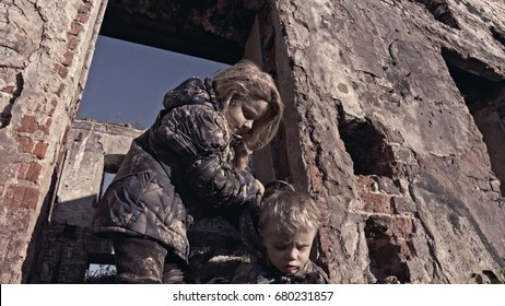 Refugee children on the ruins of a house.