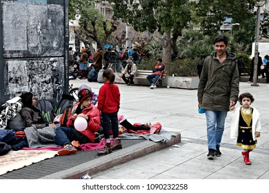 a Refugee family at the Victoria square, where hundreds of migrants and refugees stay temporarily in in Athens, Greece on Feb. 24, 2016.