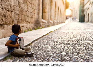 Refugee from the Middle East on the street of European city. Focus on the boy.
