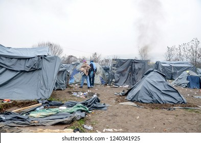 Refugee and migrant camp in Bosnia and Herzegovina near Croatian border. Velika Kladusa. Tents and people in Syrian refugee camp. European migrants crisis. Balkan Route.  Migrants from Syria, Pakistan