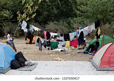 Refugees and migrants in a makeshift camp at Pedion tou Areos park where some 1500 migrants and refugees live in a makeshift camps in Athens, Greece on Aug. 10, 2015