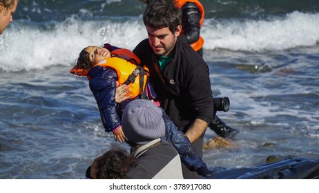 The refugees pulled out of the newly arrived boat from Turkey to the shore of the Greek island of Lesbos. Joy and suffering at the same time. November 2015