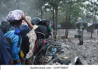 Refugees wait in a queue as they wait on the Greek - Macedonian border to pass to Macedonia.