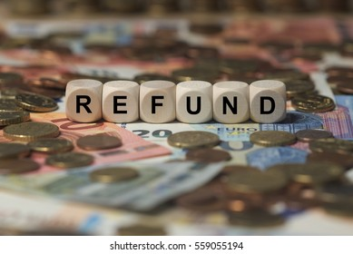 refund - cube with letters, money sector terms - sign with wooden cubes