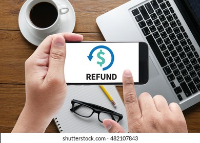 REFUND and Tax Refund Fine Duty Taxation  message on hand holding to touch a phone, top view, table computer coffee and book