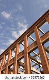 Refurbished building against blue sky