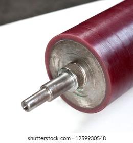 A refurbished cylindrical shaft on polyurethane sheath.