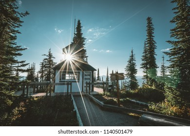 Refurbished fire tower lookout on the summit of Mount Revelstoke with sunstar. British Columbia Canada.