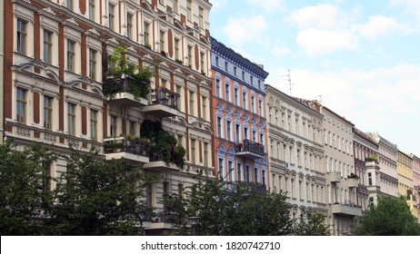 Refurbished old building facades in the green streets of the districts Prenzlauer Berg and Pankow in Berlin, Germany