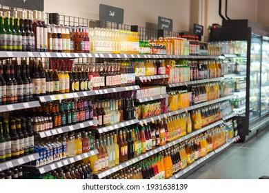 Regensburg, Germany - 2021 02 05: Shelves with bottles of refreshing soft drinks on display in german organic super market