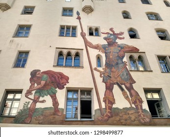 Regensburg, Germany - August 26 2015: Goliath House (Goliathhaus), a medieval structure built in 1260. The biblical narrative of David and Goliath was depicted on the facade in 1573.