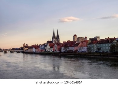 Regensburg, Germany:  Historic houses, palaces, and churches on the bank of the Danube in the light of sunset.