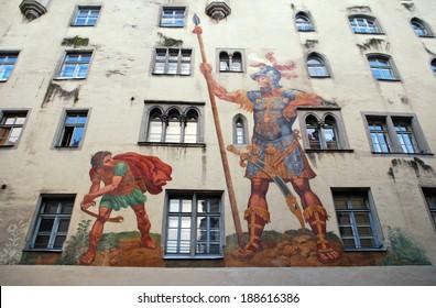 REGENSBURG, GERMANY - JANUARY 05, 2012: David and Goliath fresco on medieval house wall, Regensburg, Bavaria, Germany. Medieval center of Regensburg is a UNESCO World Heritage Site.