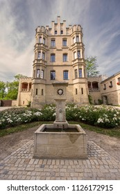 REGENSBURG, GERMANY - JUNE 21, 2018:   The Royal Villa aka Königliche Villa is a neo-Gothic 3-storey stone building with stepped gables and turrets. A flowering garden with water fountain is in front.