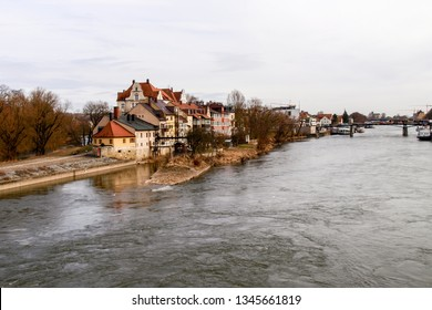 Regensburg, Germany - March 03, 2017:  Historic houses and buildings on the Danube bank.