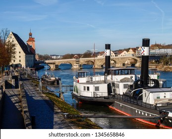 Regensburg, Germany - March 04, 2017:  Historical boats moored on the Danube.