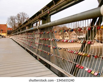 Regensburg, Germany: padlocks fixed to the metal structure of a bridge.
