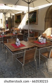 REGENSBURG, GERMANY - SEP 9, 2016 - Table and chairs outside restaurant in  Regensburg, Germany
