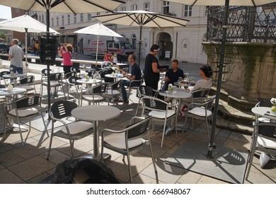 REGENSBURG, GERMANY - SEP 9, 2016 - Relaxing with coffee outdoors in  Regensburg, Germany