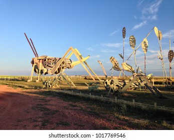"Regent, ND, USA. December, 2015. A 30-mile stretch of road in western North Dakota is dubbed ""the Enchanted Highway"" due to its eight oversized folk art sculptures, such as this metal grasshopper."