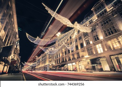 Regent Street Angels Holiday Lights with Double Decker Bus Light Trails in London, United Kingdom