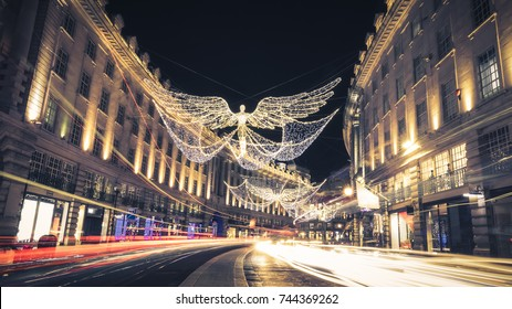 Regent Street Angels Holiday Lights with Car Light Trails in London, United Kingdom