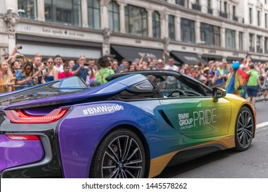 Regent Street, LONDON, UK - 6th July 2019 - Around 1.5 million people descend onto the streets of London to attend Pride In London 2019. The BMW Pride Group UK take to the streets in an i8 Supercar.