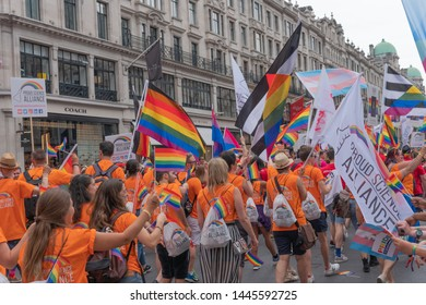 Regent Street, LONDON, UK - 6th July 2019 - Around 1.5 million people descend onto the streets of London to attend Pride In London 2019. Party goers on the streets with flags celebrating the occasion.