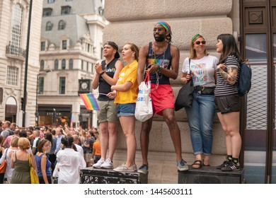 Regent Street, LONDON, UK - 6th July 2019 - Around 1.5 million people descend onto the streets of London to attend Pride In London 2019. Party goers watching the parade from Piccadilly Circus