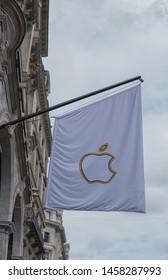 Regent Street, LONDON, UK - 6th July 2019 - Apple logo flying high over Regent Street showing LGBT colors celebrating Pride In London 2019